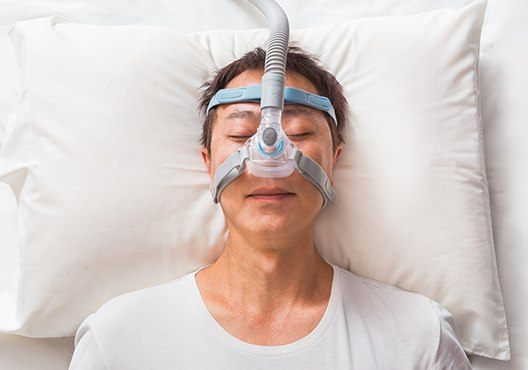 Patient sleeping with CPAP mask