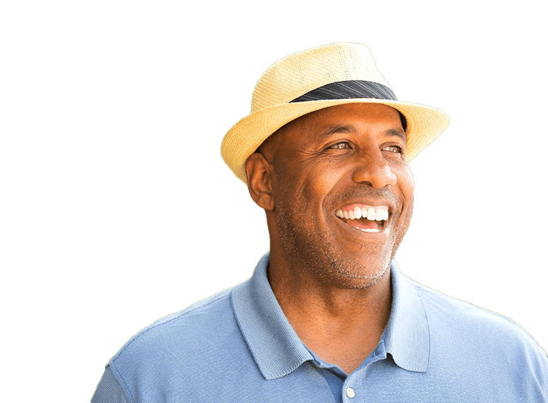 man in blue polo smiling with dental implants in Tukwila