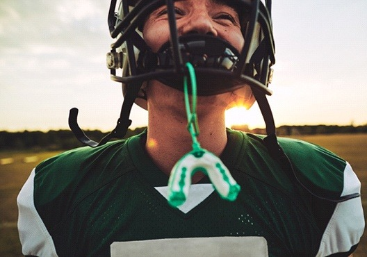Football player with mouthguard