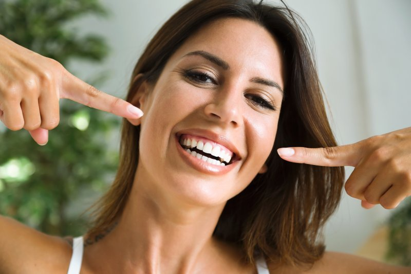 Woman after seeing cosmetic dentist in Tukwila