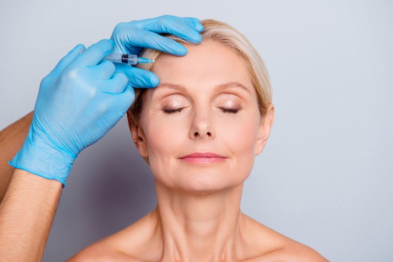 Mature woman getting BOTOX injections